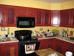 yellow and red kitchen red paint kitchen yellow cherry cabinets