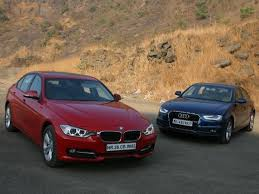 audi a3 vs bmw 3 series audi a4 177ps vs bmw 320d sportline comparison review zigwheels