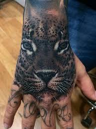 black leopard face tattoo on hand