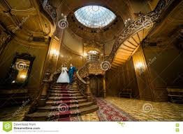 Wooden Interior Beutiful Married Couple Holding Hands Coming Down The Stairs At
