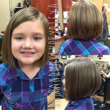 cute angled bob and stacked in the back haircut for a young