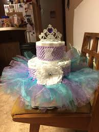 purple and teal diaper cake for a baby shower ideas