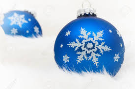 blue glass ornaments on a white fur background