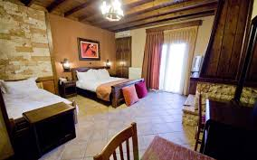 triple room with fireplace filoxenia hotel loutra pozar hotels