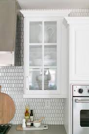 gray grout with white oval tiles transitional kitchen