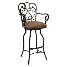 ornate black cast iron bar stool with velvet upholstered seat of
