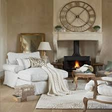 cozy living room with white grey striped sofa bed fireplace white