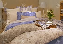 big bed pillows contemporary bedroom with big bed and pile of pillows stock photo