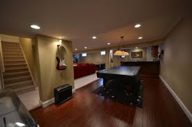 floor basement flooring options epoxy with dark wood island and