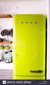 bright green smeg fridge freezer in a kitchen stock photo royalty