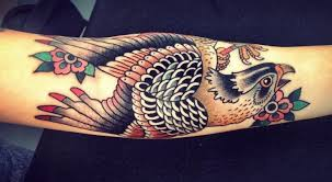 colorful traditional falcon tattoo design for arm by lina stigsson