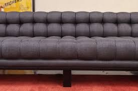 Tufted Vintage Sofa Vintage Sofa With Ebonized Finish And Biscuit Tufted Upholstery At