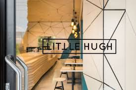 cafe interior is covered in geometric panel shapes the