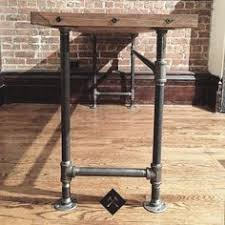 wood and pipe table via 4 men 1 lady diy plumbing pipe table tutorial i m so doing