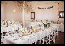 wedding backdrop australia white chairs white table cloths gold table runners