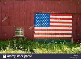 Red Barn Door by Red Barn With American Flag Painted On The Door In Hubbardston