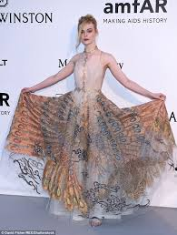 elle fanning looks like a princess in peacock patterned gown