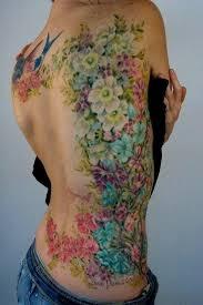 amazing flower on rib cage design idea