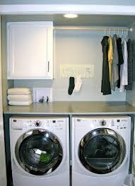 table over washer and dryer table over washer and dryer with clothes bar and cabinet to hold