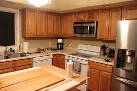 Restaining Kitchen Cabinets Darker How I Painted My Kitchen Cabinets Without Removing The Doors Diy