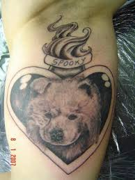 sweet dog face in lovely flaming heart shaped mirror tattoo