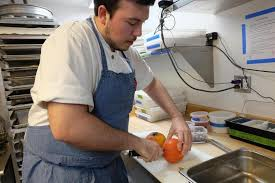 A Chef Slicing A Pumpkin by Recipe Pumpkin Flan The Boston Globe