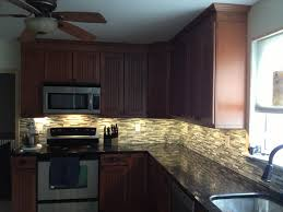 Led Backsplash Cost by Kraftmaid Maple Cinnamon Cabinets With Black Galaxy Granite