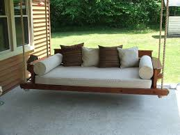 porch bed swing made with western red cedar uses a standard twin