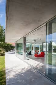 lieven dejaeghere designs a glass and concrete pool house in