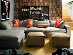 Black Book Shelves by Deluxe Gray Sofa And Padded Puffs Along With A Simply Black