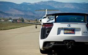 lexus lfa car and driver lexus pits lfa nurburgring against business jet in 9600 foot shootout