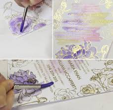 a peek into the studio purple glam watercolor wedding