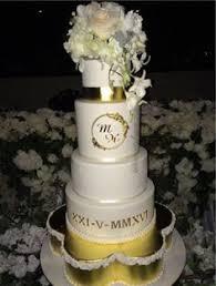 ivory wedding cake with sugar flowers made by sweetsbysuzie
