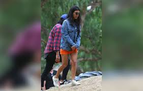 kourtney kardashian wears orange mini dress to pumpkin patch with kids