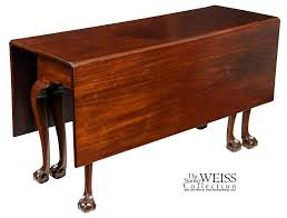 a mahogany chippendale 6 leg claw and ball drop leaf dining table