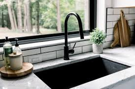 kitchen cabinet sink faucets how to buy a new kitchen faucet