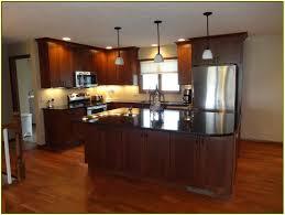 uba tuba granite with dark cabinets mf cabinets