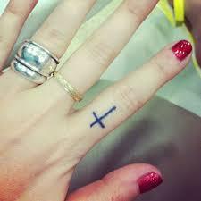 finger tattoos cross