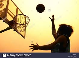 asian man playing basketball stock photo royalty free image
