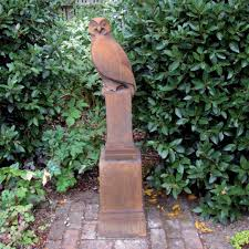 ornate large owl statue and plinth garden ornament