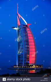 illuminated facade of the seven star hotel burj al arab at night