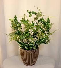 dendrobium orchid and silk plant arrangement in ceramic container