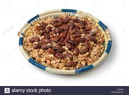 traditional moroccan festive basket with nuts and dates on white