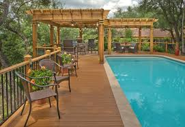 L Shade L Shade Wood Pergola And Composite Decking Around Pool