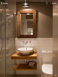 Bathroom Accents Ideas by Half White Tiles With Contrast Brown Wall And White And Brown