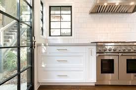 white kitchen cabinets with gold pulls los feliz kitchen remodel spazio la