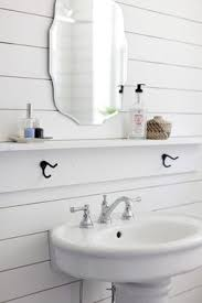 narrow sink for a small fresh white bathroom in a swedish space