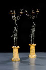 candelieri antichi coppia di candelieri in bronzo antichi a tre antiquariato e