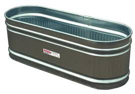 steal this look water troughs as raised garden beds gardenista