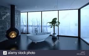 cozy modern bathroom in winter with a freestanding bathtub